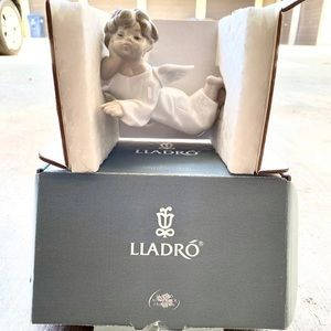 Lladro Angel Laying Down
